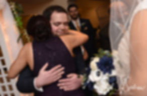 Gunnar hugs Aileen's mom during his December 2018 wedding ceremony at McGoverns on the Water in Fall River, Massachusetts.