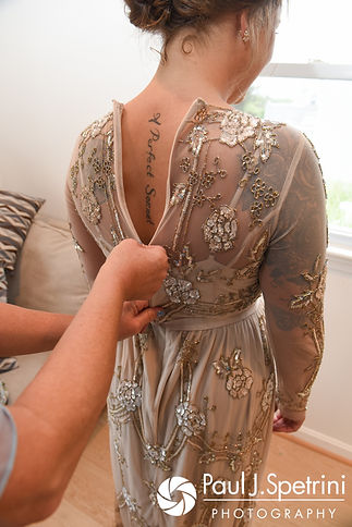 Arielle's dress is zipped up prior to her September 2017 wedding ceremony at North Beach Club House in Narragansett, Rhode Island.