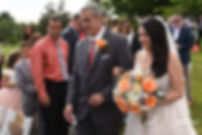 Stephanie walks down the aisle during her June 2018 wedding ceremony at Foster Country Club in Foster, Rhode Island.