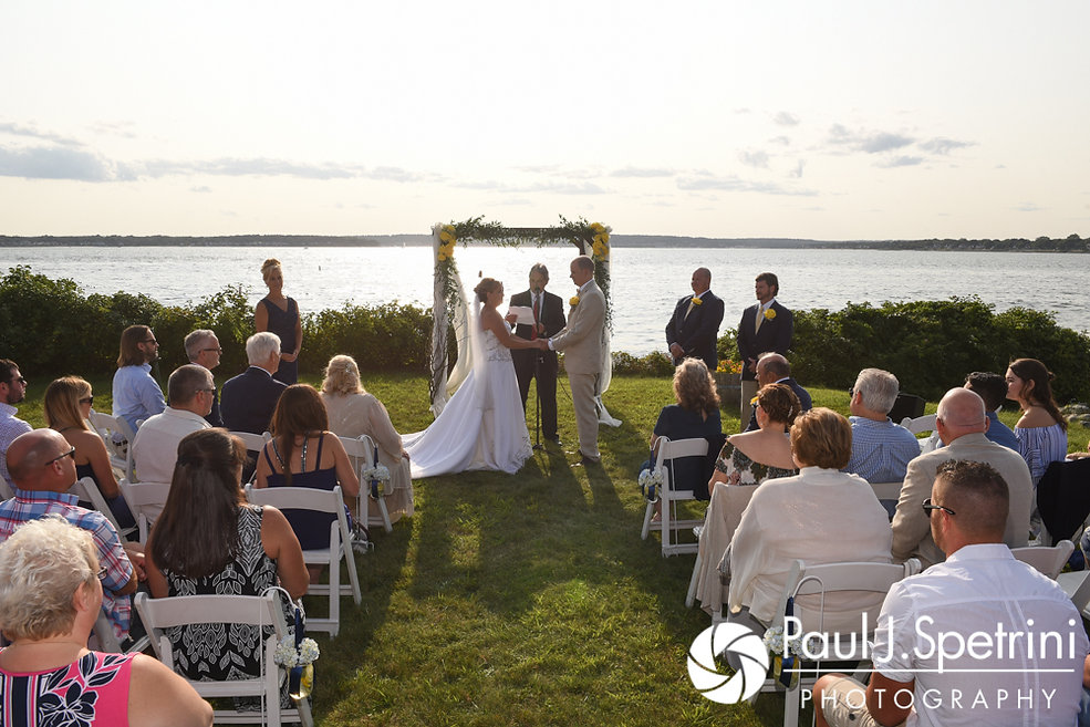 Rebecca and Kelly listen to their officiant during their August 2017 wedding ceremony in Warwick, Rhode Island.