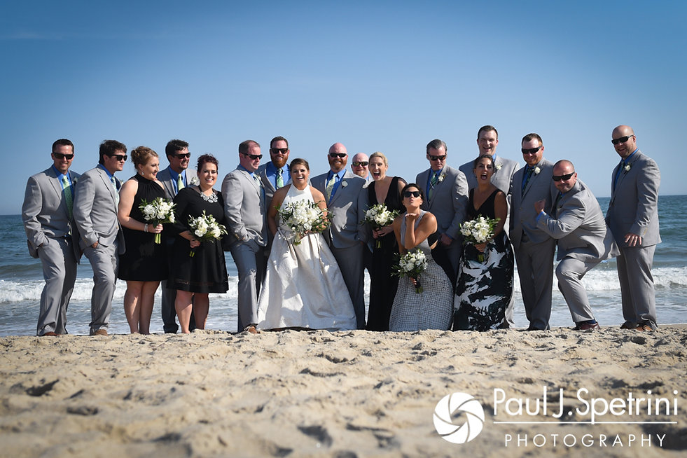 Molly and Tim pose for a formal photo with their wedding party prior to their June 2017 wedding reception at Farmhouse-By-The-Sea in Matunuck, Rhode Island.