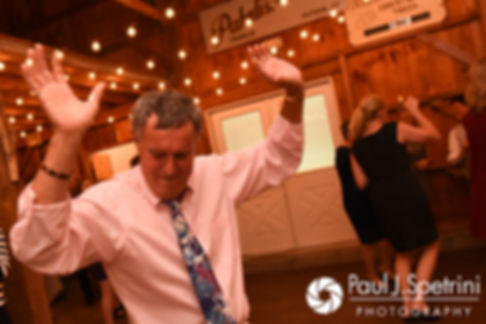 Guests dance during Kevin and Jen's September 2017 wedding reception at Allen Hill Farm in Brooklyn, Connecticut.