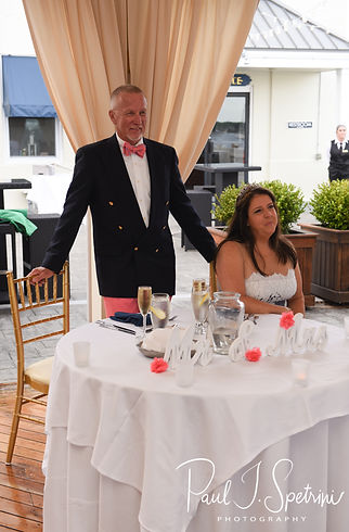 Mike and Kate listen to a toast during their May 2018 wedding ceremony aboard the Schooner Aurora boat in the waters off Newport, Rhode Island.
