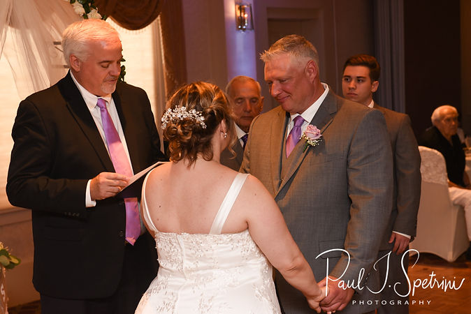 Robin and Rick listen to their officiant during their August 2018 wedding ceremony at Twelve Acres in Smithfield, Rhode Island.