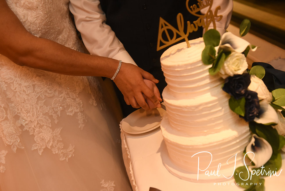 Gunnar & Aileen cut their wedding cake during their December 2018 wedding reception at McGoverns on the Water in Fall River, Massachusetts.