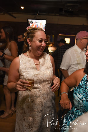 Courtney smiles during her September 2018 wedding afterparty at Pub on Park in Cranston, Rhode Island.