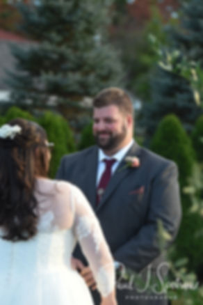 Steve looks at Katie during his October 2018 wedding ceremony at The Villa at Ridder Country Club in East Bridgewater, Massachusetts.