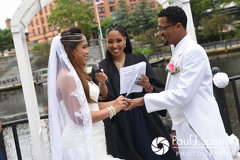 Lucelene and Luis exchange rings during their June 2017 wedding ceremony at Waterplace Park in Providence, Rhode Island.