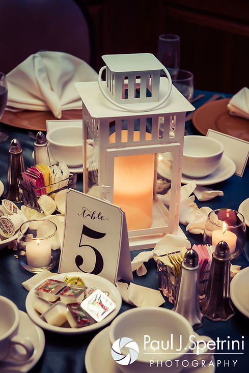 A look at the centerpieces on display during Jennifer and Mark's September 2016 wedding reception at the RI Shriners and Imperial Room at Rhodes Place in Providence, Rhode Island.