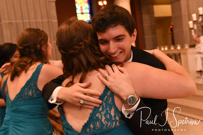 Brian receives a hug during his June 2018 wedding ceremony at the College of the Holy Cross in Worcester, Massachusetts.