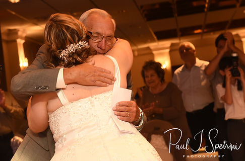 The best man hugs the bride during Robin & Rick's August 2018 wedding reception at Twelve Acres in Smithfield, Rhode Island.