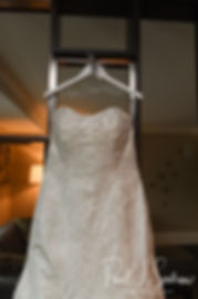 Sarah's dress hangs during her bridal prep session at The Omni Hotel in Providence, Rhode Island prior to her October 2018 wedding.