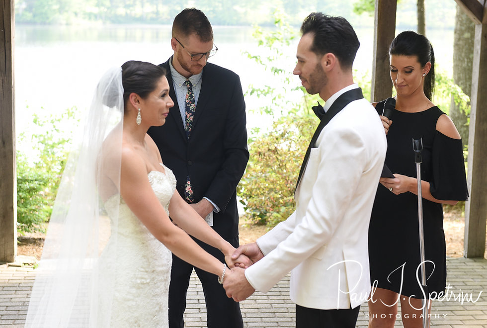 Kendra and Joe listen to a reading during their May 2018 wedding ceremony at Crystal Lake Golf Club in Mapleville, Rhode Island.