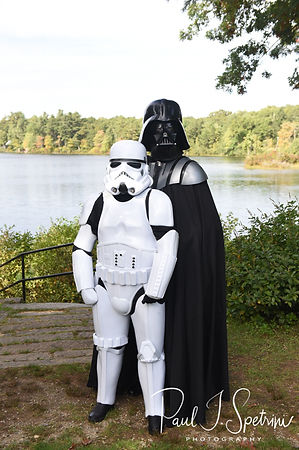 Darth Vader and a Stormtrooper pose for a formal photo during Amanda & Josh's October 2018 wedding reception at Loon Pond Lodge in Lakeville, Massachusetts.