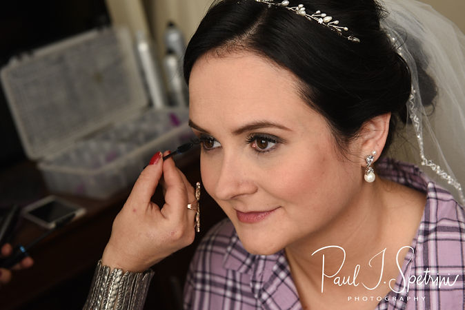 Justine her her makeup applied prior to her October 2018 wedding ceremony at Twelve Acres in Smithfield, Rhode Island.