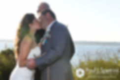 Marissa and Paul share their first kiss during their September 2016 wedding ceremony at Beavertail Lighthouse in Jamestown, Rhode Island.