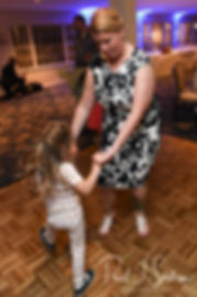 Marijke dances with a guest during her June 2018 wedding reception at Independence Harbor in Assonet, Massachusetts.