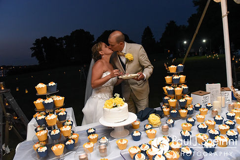 Rebecca and Kelly kiss after cutting their cake during their August 2017 wedding reception in Warwick, Rhode Island.
