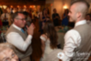 Friends and family members clap for Krystal and Ian during their May 2016 wedding reception at DeWolf Tavern in Bristol, Rhode Island.