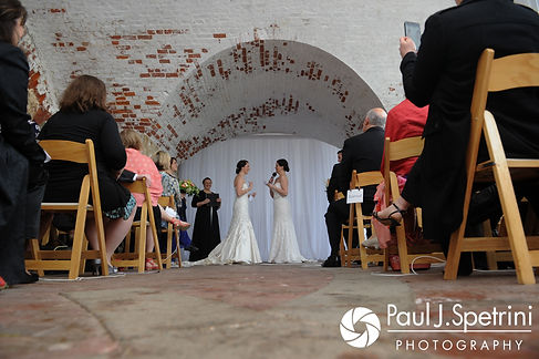 Caroline and Morgan read their vows to each other during their April wedding ceremony at the Fort Adams Trust in Newport, Rhode Island.