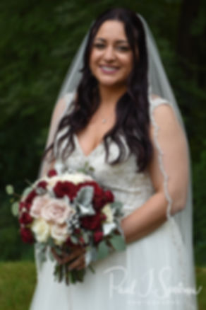 Lizzy smiles for a photo prior to her September 2018 wedding ceremony at Crystal Lake Golf Club in Mapleville, Rhode Island.