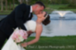 Laura and Kevin share a kiss during their May 2015 wedding at the Warwick Country Club in Warwick, Rhode Island.