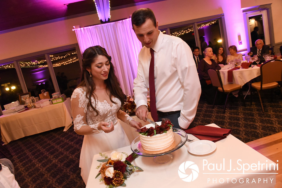 Keiran and Jessica cut the cake during their October 2017 wedding reception at Crystal Lake Golf Club in Mapleville, Rhode Island.