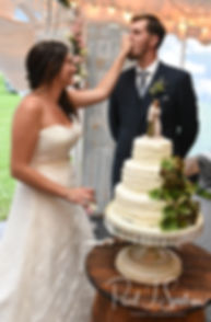 Karolyn & Ethan cut their wedding cake during their August 2018 wedding reception at a private residence in Sterling, Connecticut.