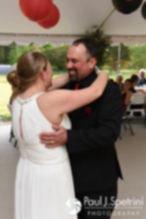 Latasha dances with her father at her May 2016 wedding reception at Country Gardens in Rehoboth, Massachusetts.