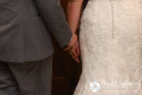 Crystal and Andy hold hands following their November 2016 wedding ceremony at the Salem Cross Inn in West Brookfield, Massachusetts.