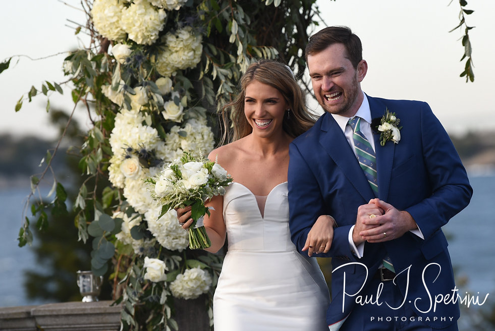 David and Whitney smile as they walk down the aisle following their October 2018 wedding ceremony at Castle Hill Inn in Newport, Rhode Island.