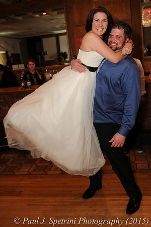 Justin and Jamie Bolani pose for a photo at the end of their June wedding in Rhode Island.