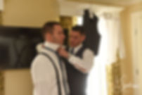 Kurt has help with his tie prior to his November 2018 wedding ceremony at the Publick House Historic Inn in Sturbridge, Massachusetts.