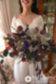 Samantha holds her flowers for a photo prior to her October 2017 wedding ceremony at St. Robert's Church in Johnston, Rhode Island.