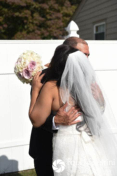 Stephany and her father hug following a first look prior to her September 2017 wedding ceremony at Wannamoisett Country Club in Rumford, Rhode Island.