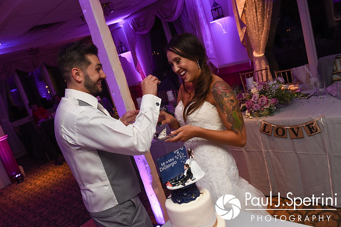 Stacey and John cut their wedding cake during their September 2017 wedding reception in Warren, Rhode Island.