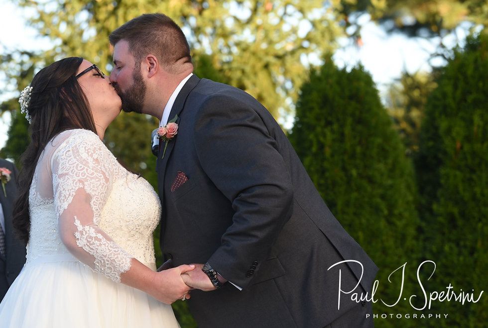 Katie and Steve kiss during their October 2018 wedding ceremony at The Villa at Ridder Country Club in East Bridgewater, Massachusetts.