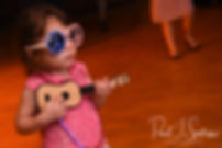 A little girl plays a toy guitar during Adam & Ashley's September 2018 wedding reception at Stepping Stone Ranch in West Greenwich, Rhode Island.