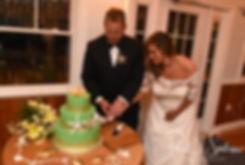 Cara & Brandon cut their wedding cake during their November 2018 wedding reception at the North Beach Clubhouse in Narragansett, Rhode Island.