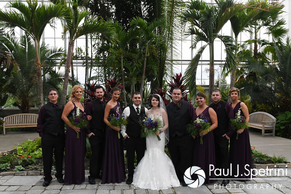 Jen and Kyle post for a photo with their wedding party prior to their September 2016 wedding at the Roger Williams Park Botanical Center in Providence, Rhode Island.