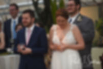 Ali and Gary listen to a speech during their May 2018 wedding reception at the Roger Williams Park Botanical Center in Providence, Rhode Island.