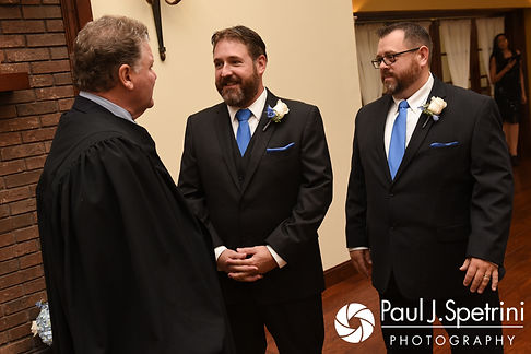 Kevin and his best man talk to his officiant prior to his October 2017 wedding ceremony at Cranston Country Club in Cranston, Rhode Island.
