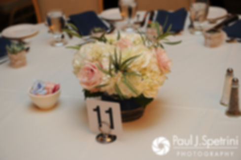 A look at the centerpieces during Nathan and Amy's November 2017 wedding reception at Quidnessett Country Club in North Kingstown, Rhode Island.