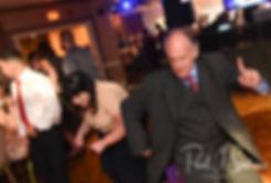 Guests dance during Justine & Jon's October 2018 wedding reception at Twelve Acres in Smithfield, Rhode Island.