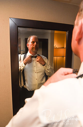 Bob puts his tie on prior to his August 2018 wedding ceremony at the Walter J. Dempsey Memorial Bandstand in Norwood, Massachusetts.