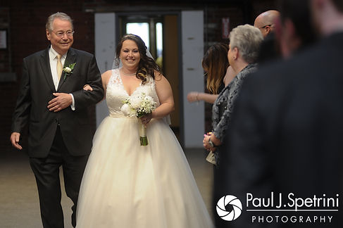 Meridith walks down the aisle with her father during her May 2017 wedding ceremony at the Hope Artiste Village in Pawtucket, Rhode Island.