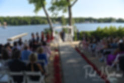 A wide angle shot of the ceremony location during Jimmy & Saken's July 2018 wedding ceremony at Lake Pearl in Wrentham, Massachusetts.