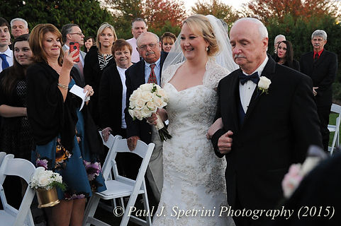 Kerry and her father walk down the aisle at her fall wedding at Quidnessett Country Club in North Kingstown, Rhode Island on October 23rd, 2015.