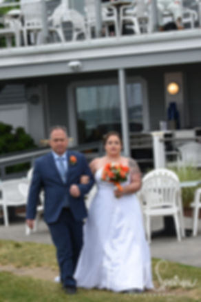 Samantha walks down the aisle during her June 2018 wedding ceremony at Chelo's Waterfront Bar & Grille in Warwick, Rhode Island.