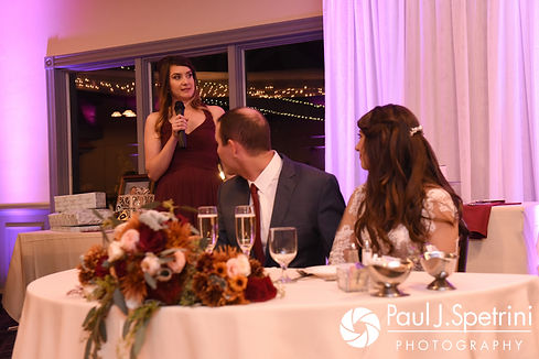Keiran and Jessica listen to Keiran's sister's speech during their October 2017 wedding reception at Crystal Lake Golf Club in Mapleville, Rhode Island.